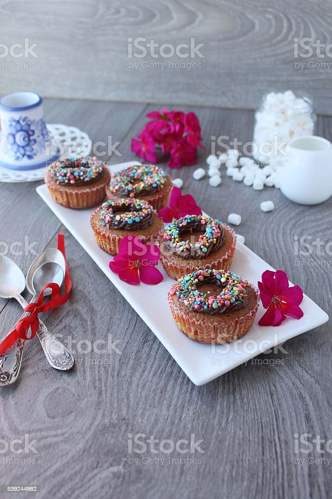pumpkin cupcakes with chocolate cream and colored sprinkles royalty-free stock photo
