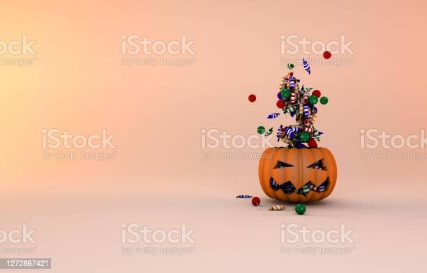 Pumpkin For Halloween Celebration And Flying Candies - Fotografie stock e altre immagini di Arancione