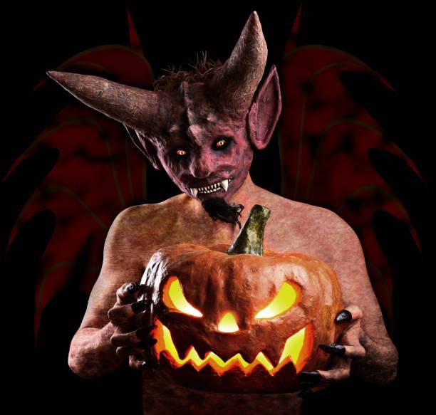 Citrouille Halloween dans les mains du diable - Photo