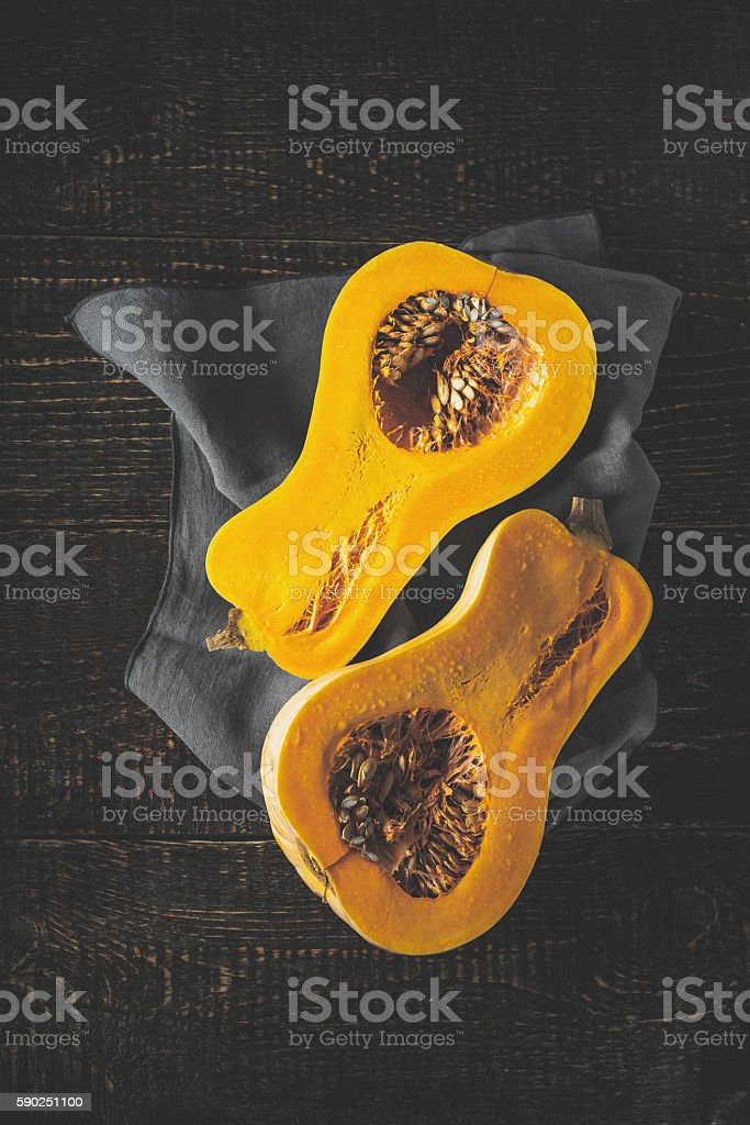 Pumpkin halves on the old wooden table vertical stock photo