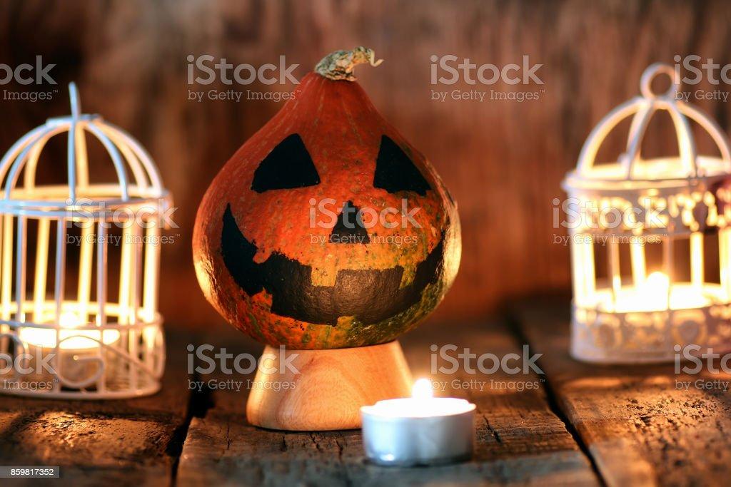 pumpkin head and candles decor stock photo