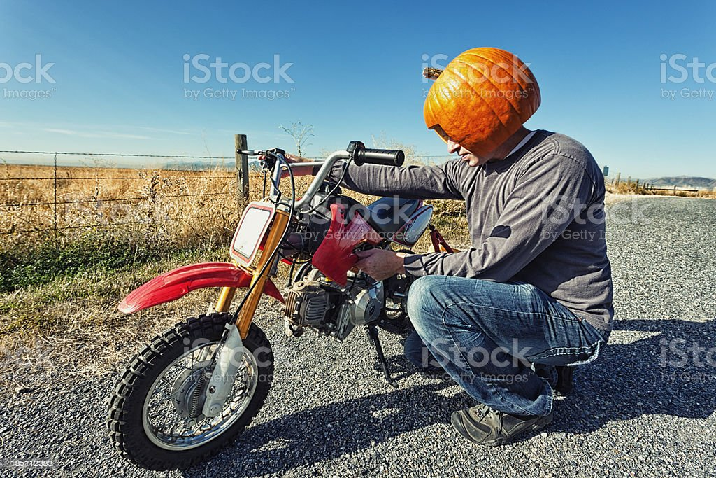 Pumpkin Head Motorcycle Maintenance stock photo