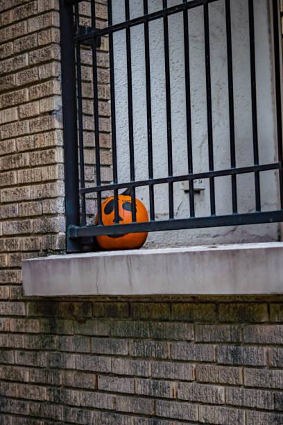 Pumpkin hiding on porch stock photo