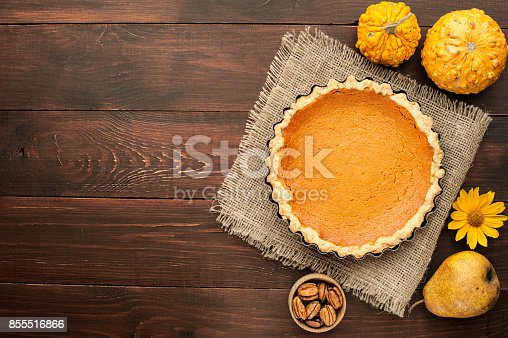 istock pumpkin homemade pie at wooden background arranged with food ingredients top view 855516866