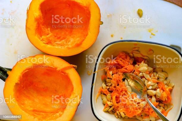 Pumpkin Innards Closeup Showing The Empty Pumpkin Next To It Stock Photo - Download Image Now