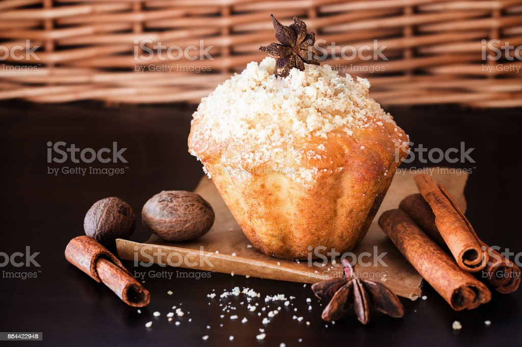 Pumpkin Oats streusel Muffins and spice nutmeg, cinnamon, anise. Wooden dark brown background. Selective focus. Copy space. stock photo