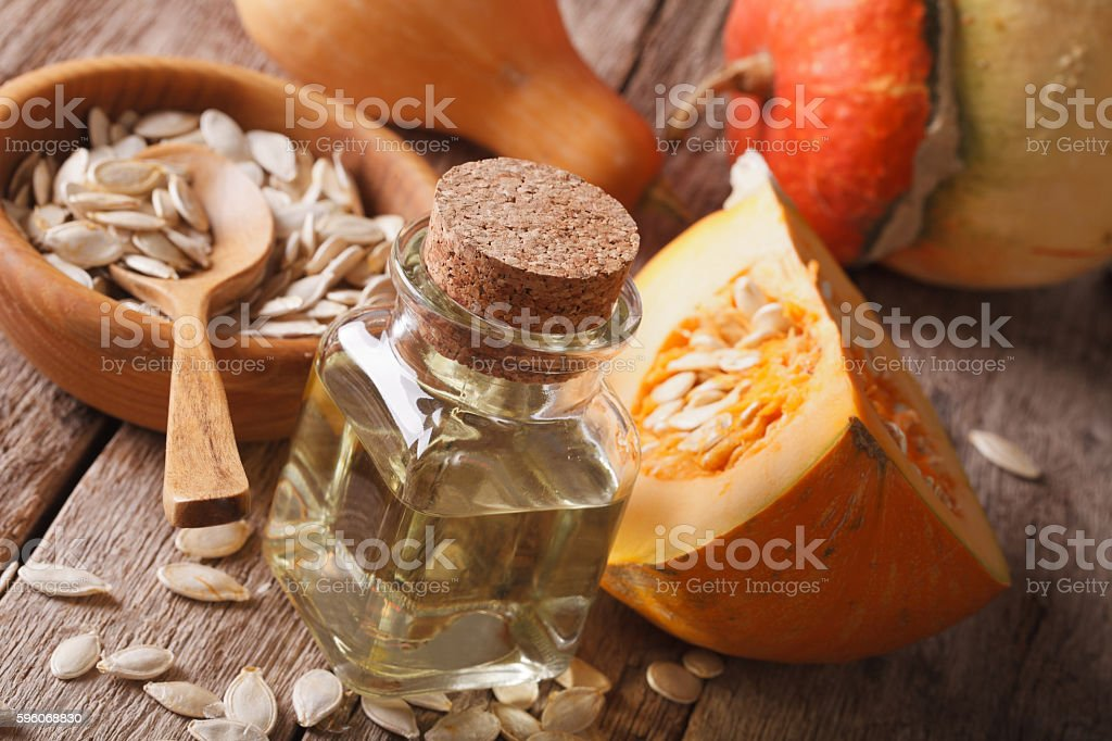 pumpkin oil on the table close-up and ingredients. Horizontal royalty-free stock photo