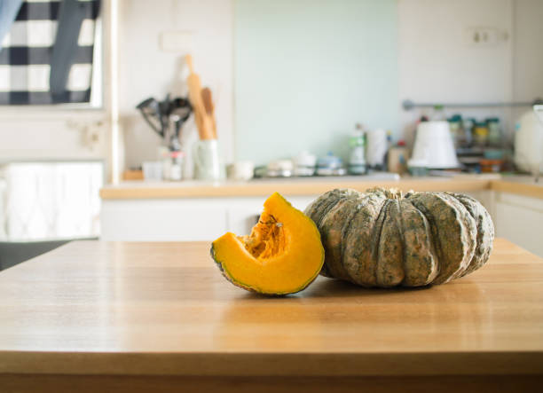pumpkin on a wooden table stock photo