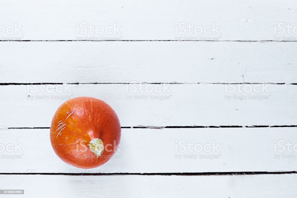 Pumpkin on white wooden table stock photo