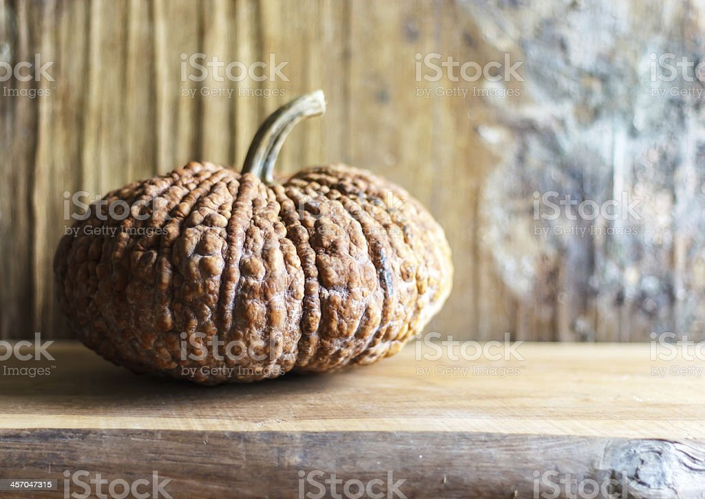 Pumpkin on wooden table royalty-free stock photo