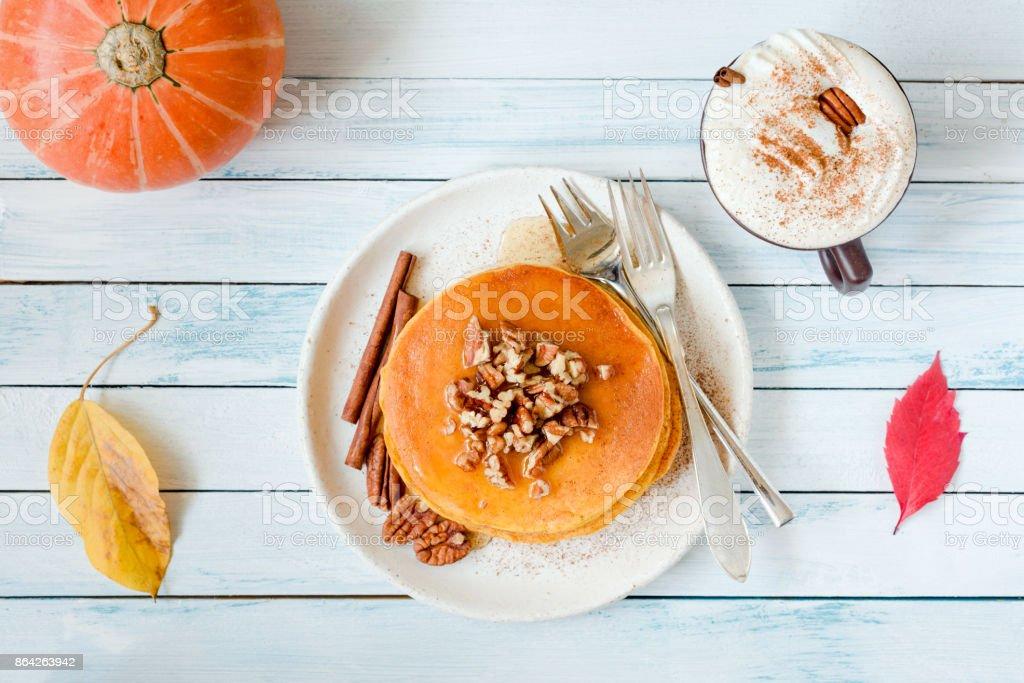 Pumpkin pancakes and pumpkin spice latte royalty-free stock photo