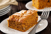 Fall Baking - Slice of pumpkin,pecan, and coconut cake with ingredients.  Please see my portfolio for other food and drink images.