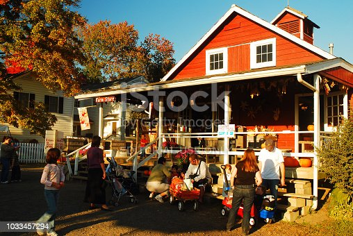 Princeton, NJ, USA A farm stand near Princeton, New Jersey in autumn brings out many families for pumpkin picking