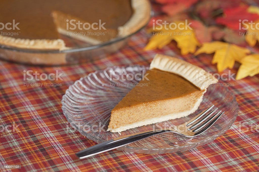 Pumpkin Pie and Slice stock photo