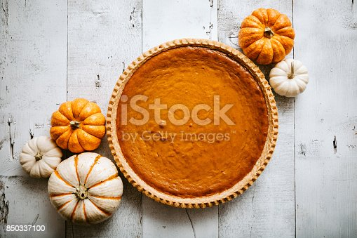 istock Pumpkin Pie on Rustic Background 850337100
