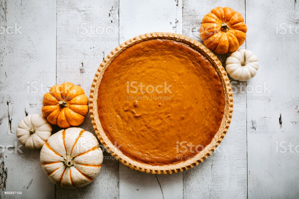 Pumpkin Pie on Rustic Background stock photo