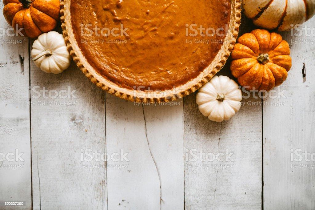 Pumpkin Pie on Rustic Background stock photo