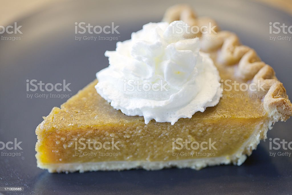 Pumpkin Pie Slice Close Up with Whipped Cream royalty-free stock photo