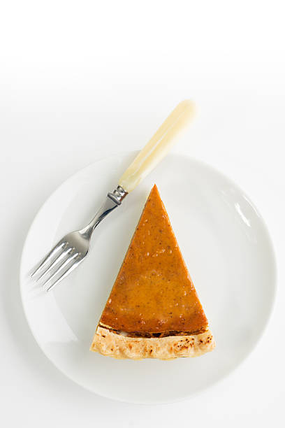 pumpkin pie slice, thanksgiving baked dessert with white plate, fork - pumpkin pie 個照片及圖片檔