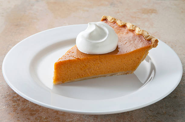 Pumpkin Pie Slice With Whipped Cream on Marble Table.