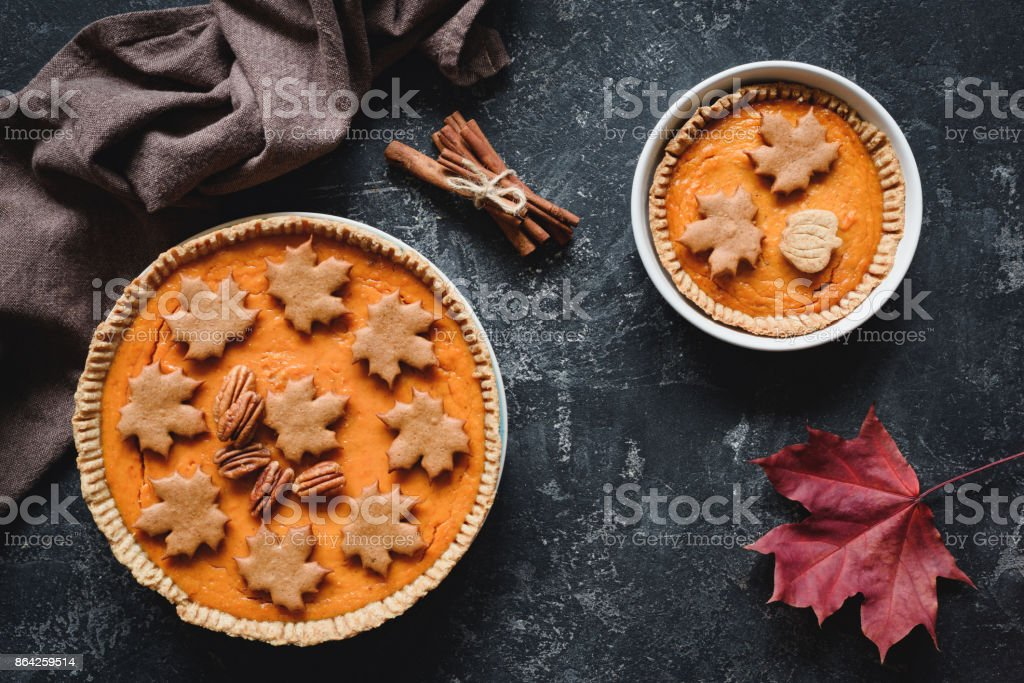 Pumpkin pies with pecan nuts on stone background royalty-free stock photo