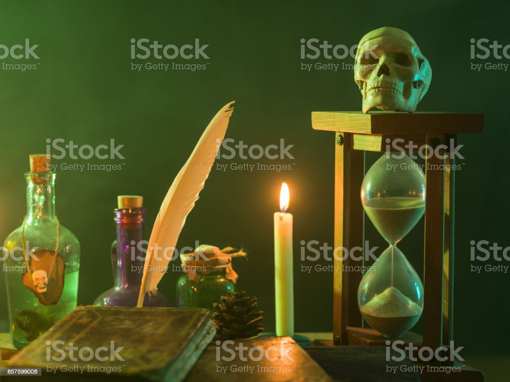 Pumpkin, Poison Bottle, Dead Insects, Candles, Human Skull and Magic Book For Halloween stock photo
