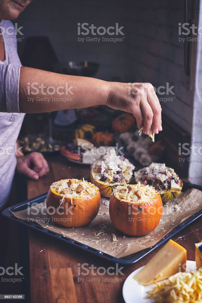 Pumpkin Risotto Baked with Cheese in a Pumpkin stock photo