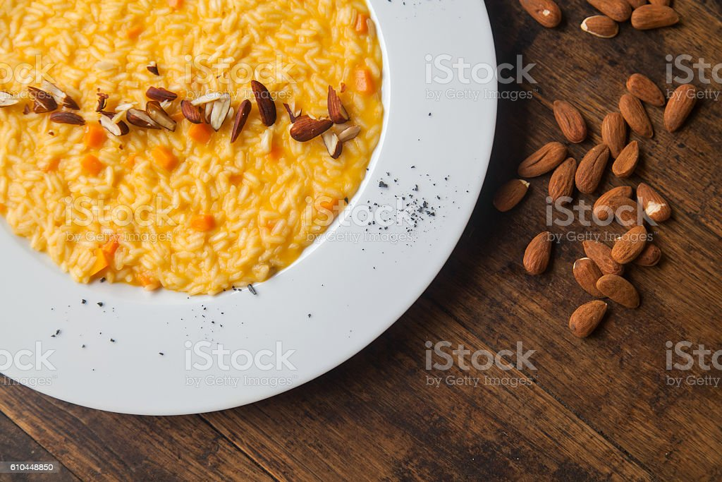 Pumpkin risotto on the plate - a traditional Italian recipe stock photo