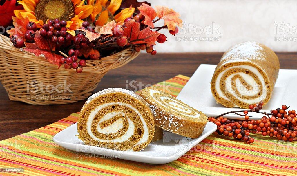 Pumpkin Roll Cake in an Autumn setting. stock photo