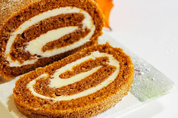 Pumpkin Roll with white icing stock photo