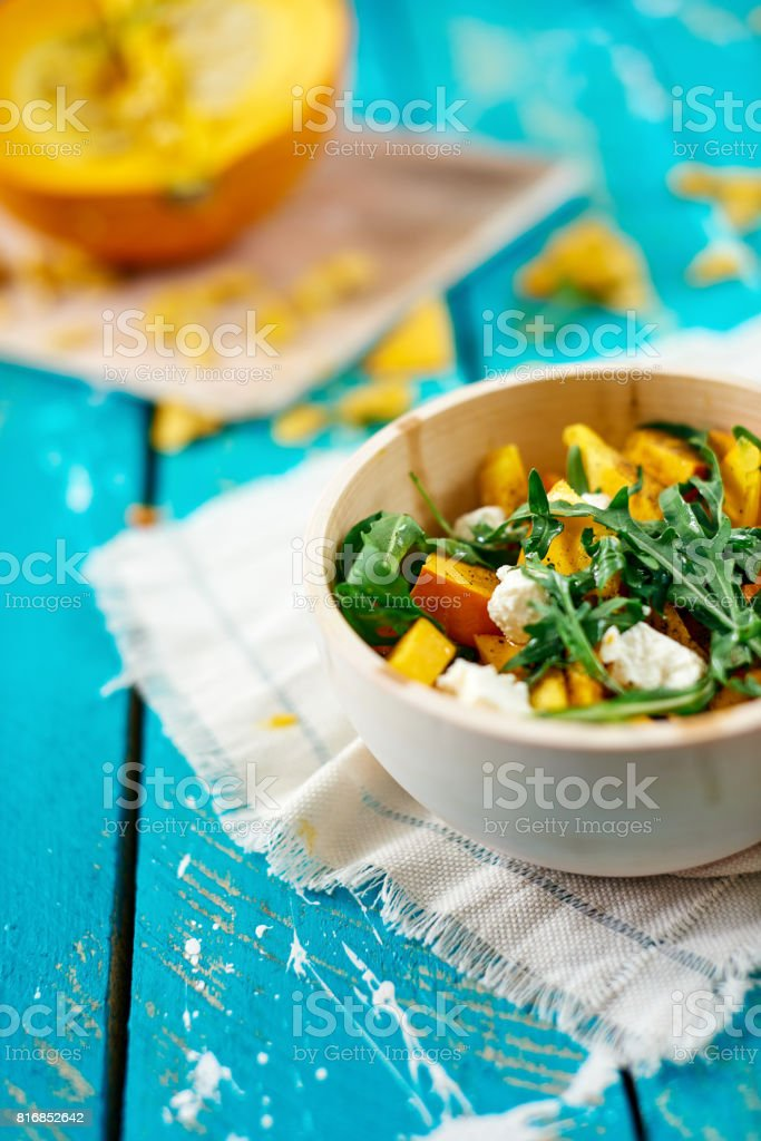 Pumpkin salad on blue table stock photo
