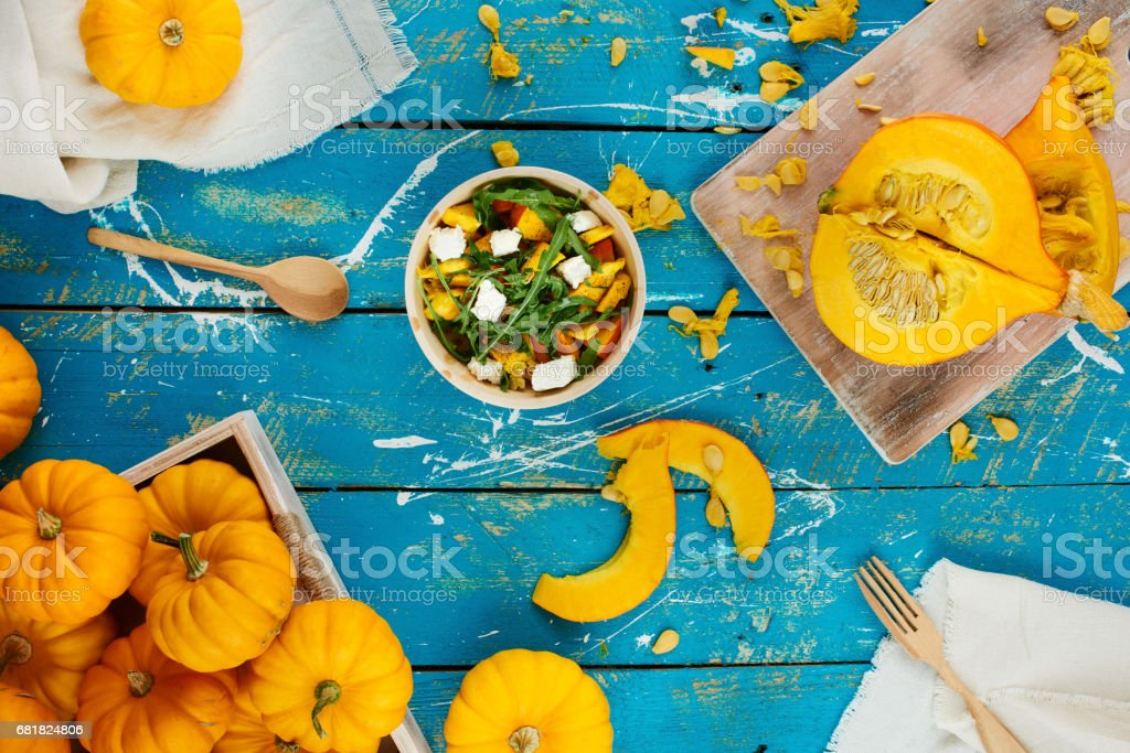 Pumpkin salad on wooden table stock photo