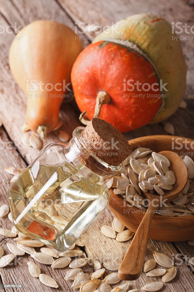 pumpkin seed oil in a glass jar on the table royalty-free stock photo