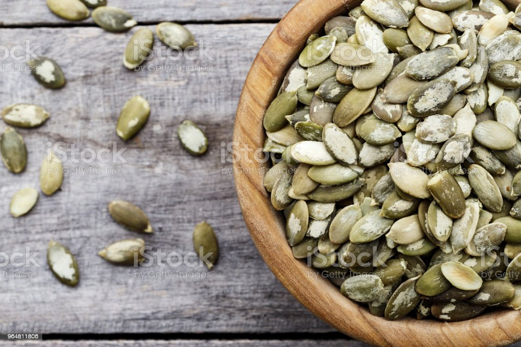 pumpkin seeds in a plate. Space for text royalty-free stock photo