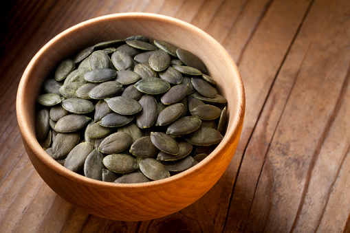 Pumpkin Seeds In Wooden Bowl Stock Photo - Download Image Now
