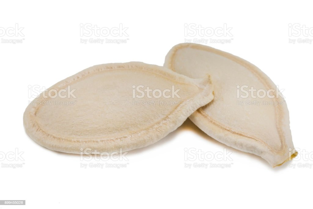 Pumpkin seeds isolated on the white background stock photo