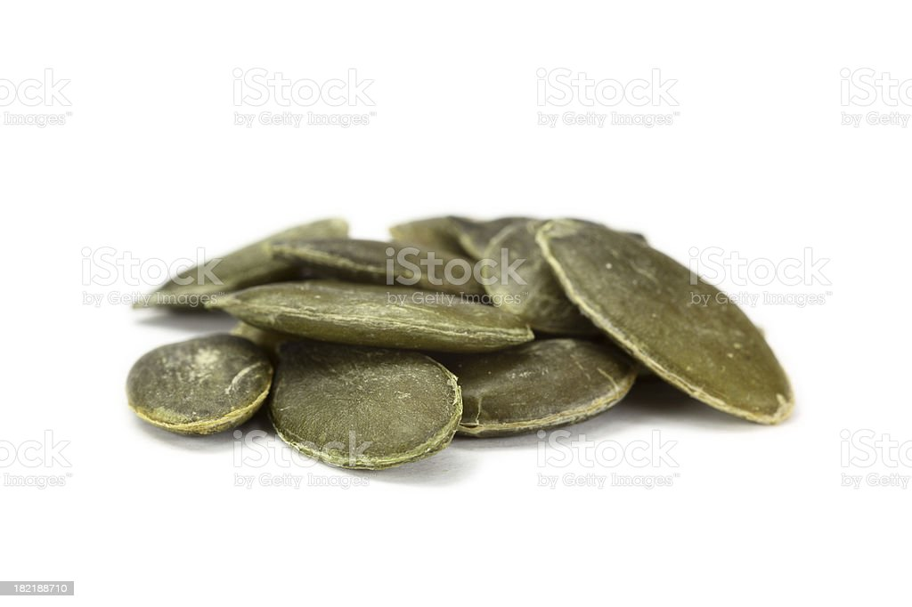 pumpkin seeds isolated on white stock photo