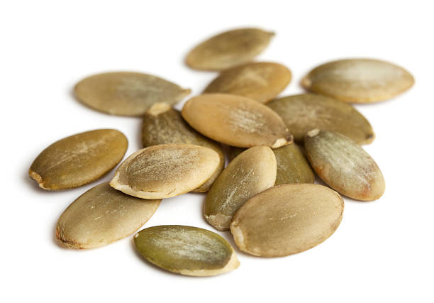 Pumpkin seeds isolated stock photo