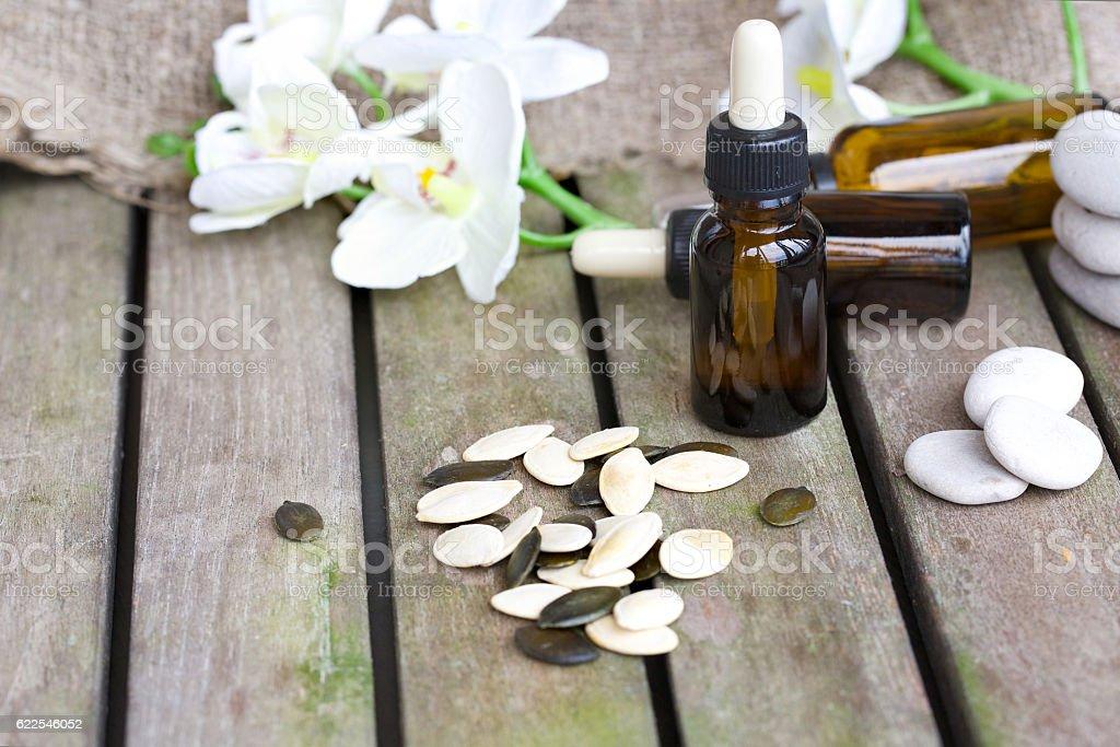 Pumpkin seeds oil in a dropper bottle stock photo