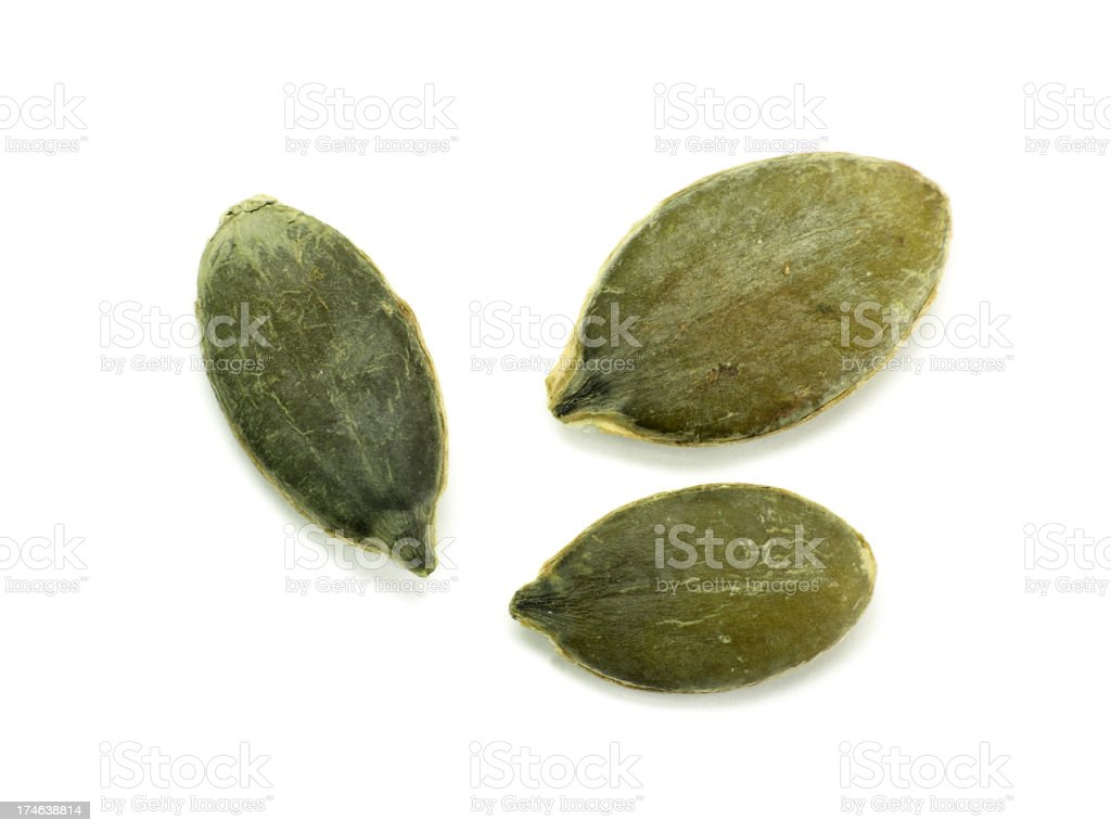 Pumpkin seeds on white background stock photo