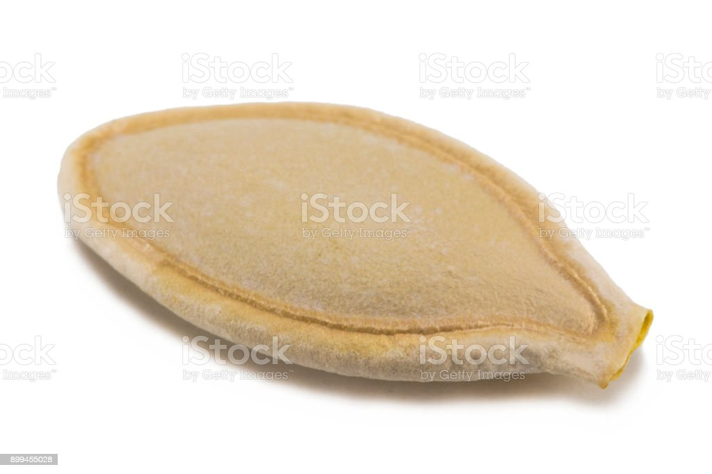 Pumpkin seeds or pepitas, isolated on white background. Overhead view stock photo