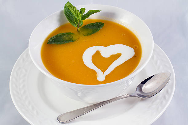 Pumpkin soup artistic heart rosemary flavor stock photo