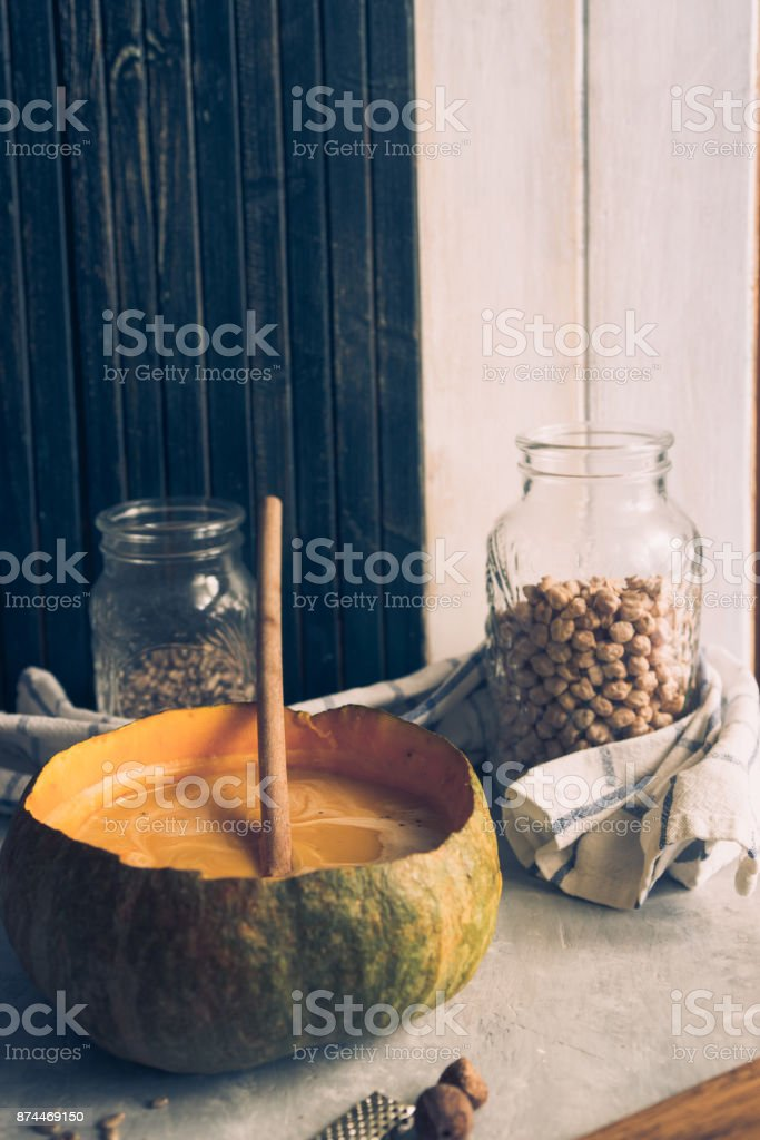 Pumpkin soup on the table stock photo