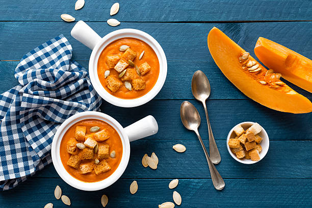 pumpkin soup - gourd stock photos and pictures