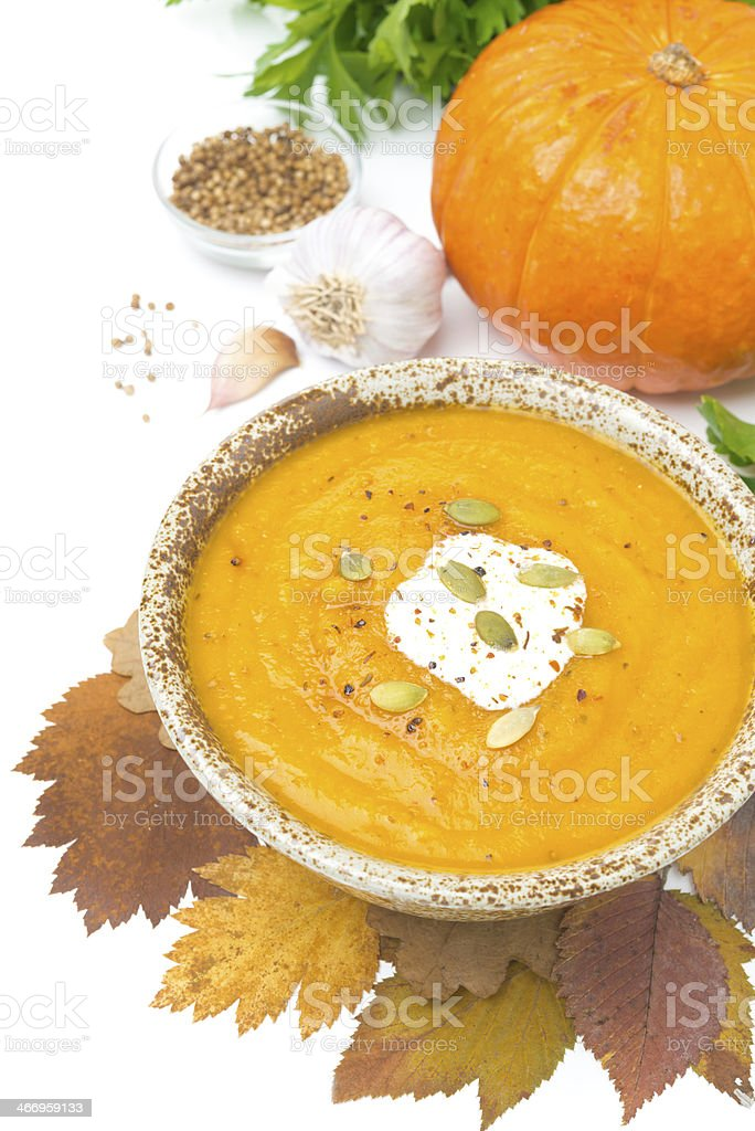pumpkin soup with coriander and cream, isolated royalty-free stock photo