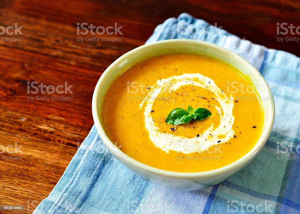 Pumpkin soup with cream stock photo