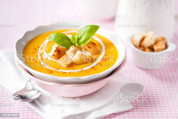 Pumpkin Soup With Croutons And Basil Stock Photo - Download Image Now
