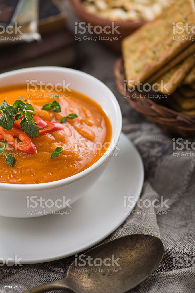 Pumpkin soup with dry tomatoes and red chilli stock photo