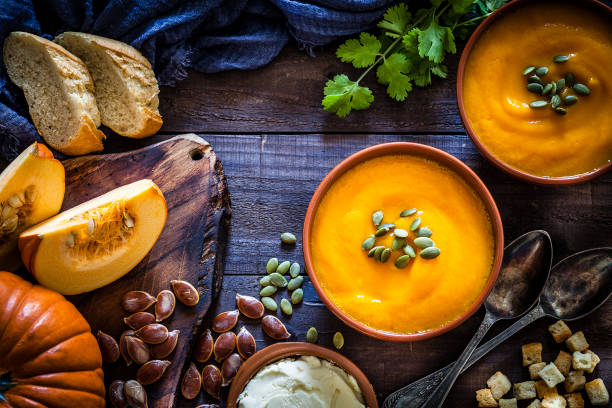 pumpkin soup with ingredients on rustic wooden table - pumpkin zdjęcia i obrazy z banku zdjęć