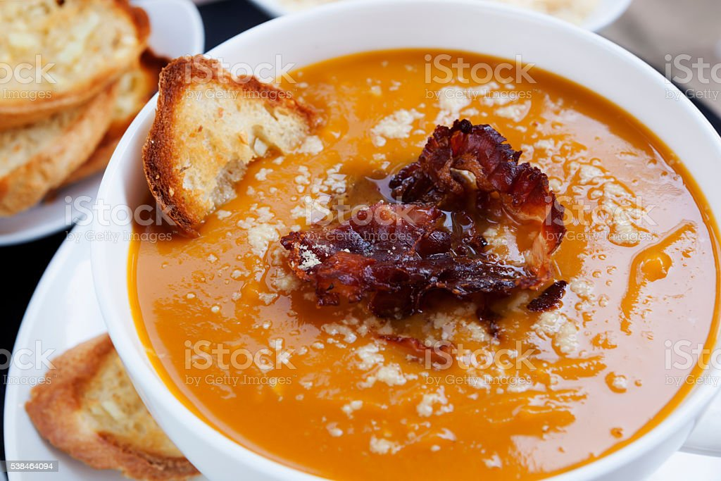 Pumpkin Soup with Pancetta Parmesan and Garlic Bread stock photo